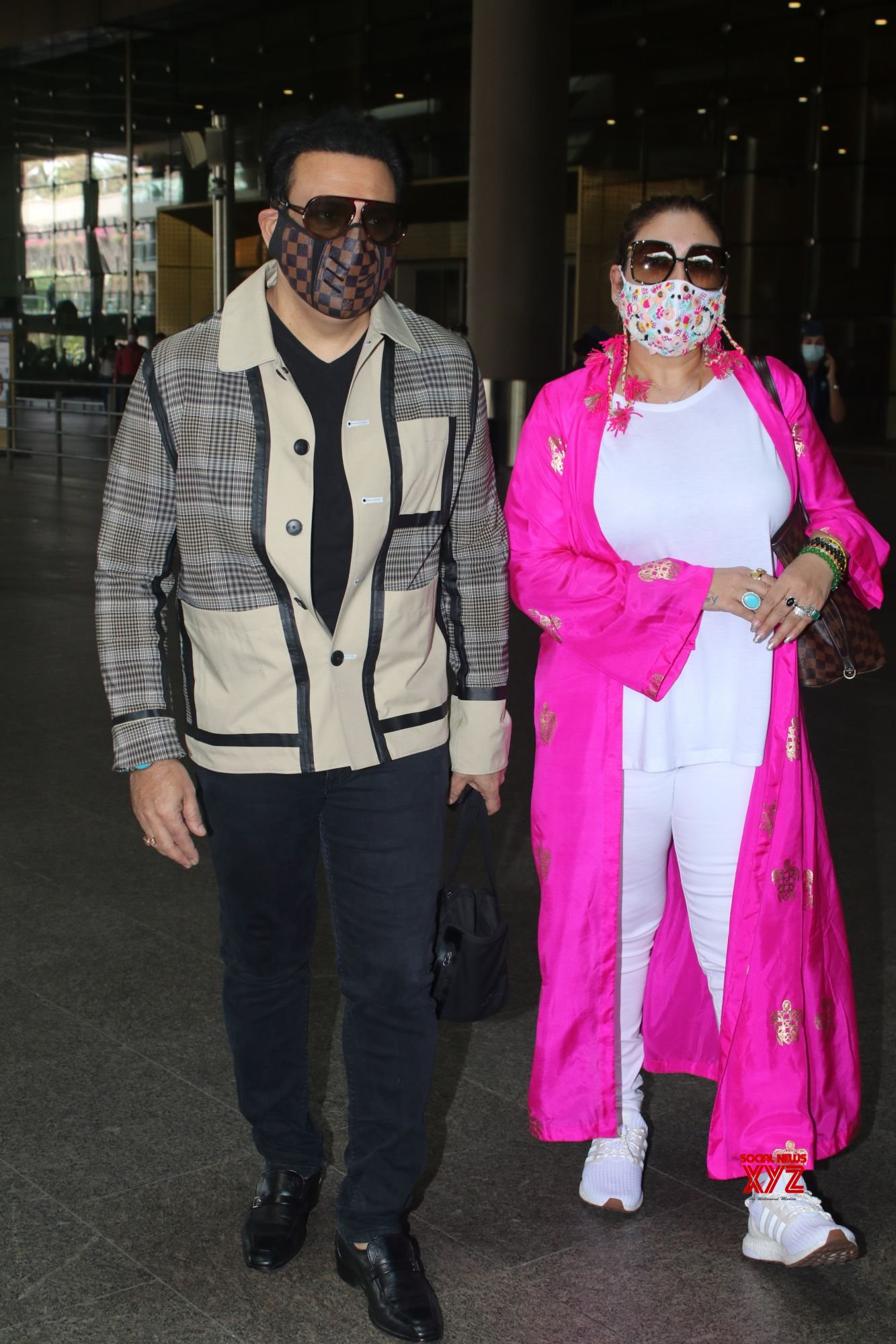 Govinda And Wife Sunita Ahuja Spotted At Airport Departure - Gallery