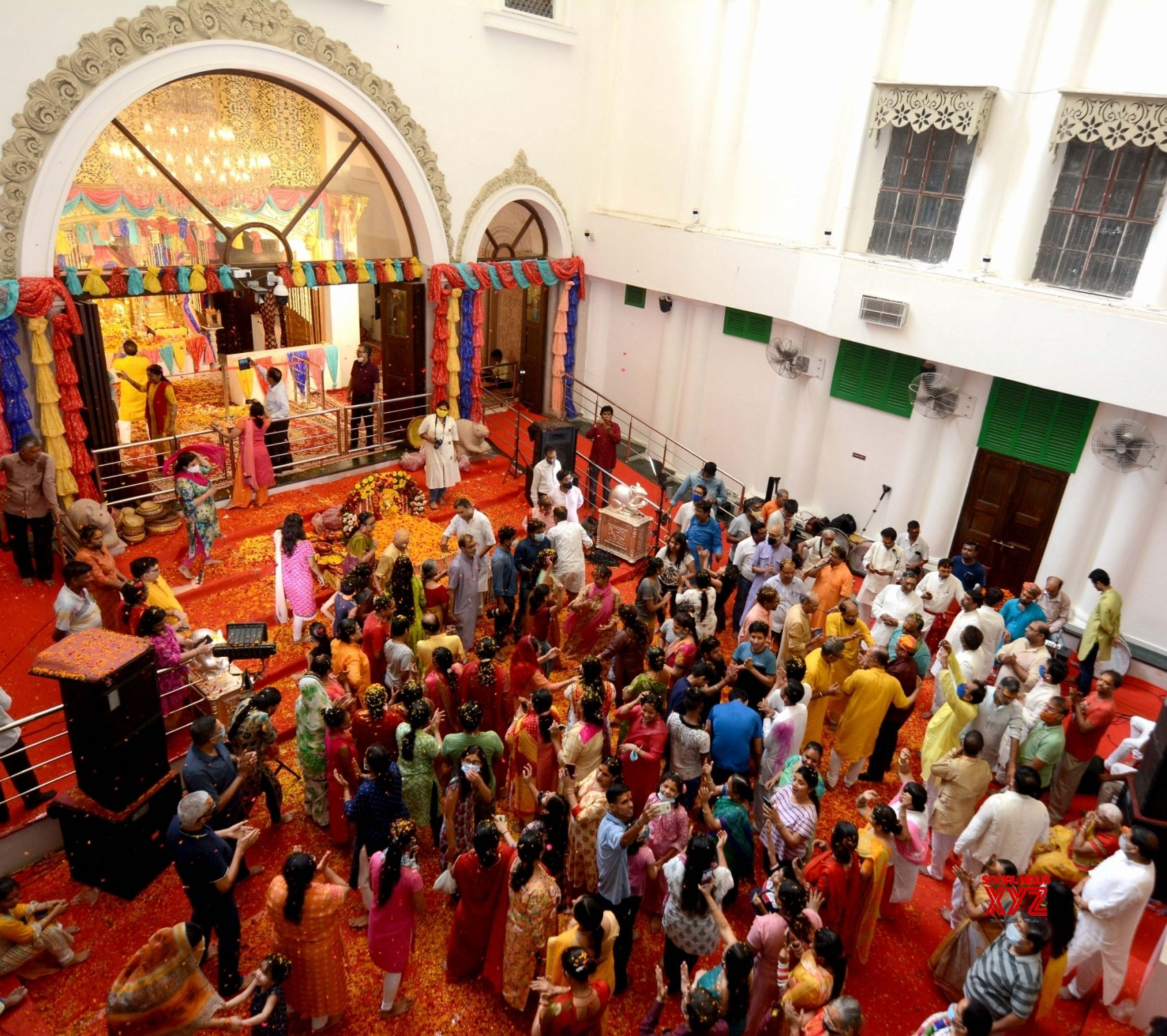 Kolkata: Devotees play with flower petals called 'Phool Dol' or Holi celebrations at Ganesh temple #Gallery