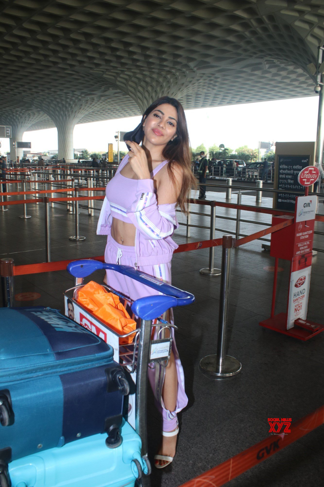 Actress Nikki Tamboli Spotted At Airport Departure - Gallery