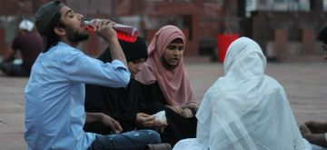 New Delhi : Muslims break the fast during the first day of Holy month of Ramadan at Jama mosque in New Delhi on Wednesday April 14, 2021. (Photo: Qamar Sibtain/IANS)
