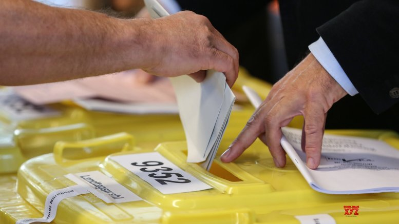 Germany's ruling conservative union gains voters' favour
