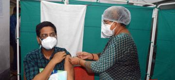 Kolkata: Health workers give the 1st dose of vaccine to the Government workers  during increasing numbers of COVID 19 cases in Kolkata   24 May, 2021. (Photo: Kuntal Chakrabarty/ IANS)