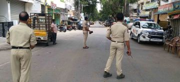 Hyderabad :   Police stick vehicle checking  again   after Lockdown is  extended of  relaxation hours  in Hyderabad, Monday 31 May 2021.  (Photo: IANS)