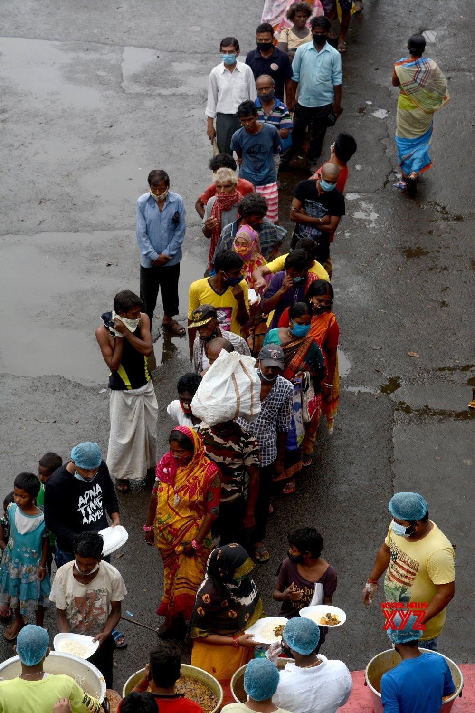 Kolkata: Volunteers distribute food to poor people during the lockdown for COVID 19 Coronavirus pandemic - in Kolkata. #Gallery