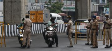 Chennai: Commuters being intercepted by police personnel during a complete lockdown imposed in Chennai in the wake of COVID-19 pandemic, on July 2, 2020. Tamil Nadu Chief Minister K. Palaniswami on Monday extended the Covid-19 lockdown till July 30, with some relaxations. The complete lockdown imposed in Chennai, Thiruvallur, Kancheepuram and Chengalpattu from June 19 onwards and in Madurai from July 24 onwards will be extended till July 5.(Photo: IANS)