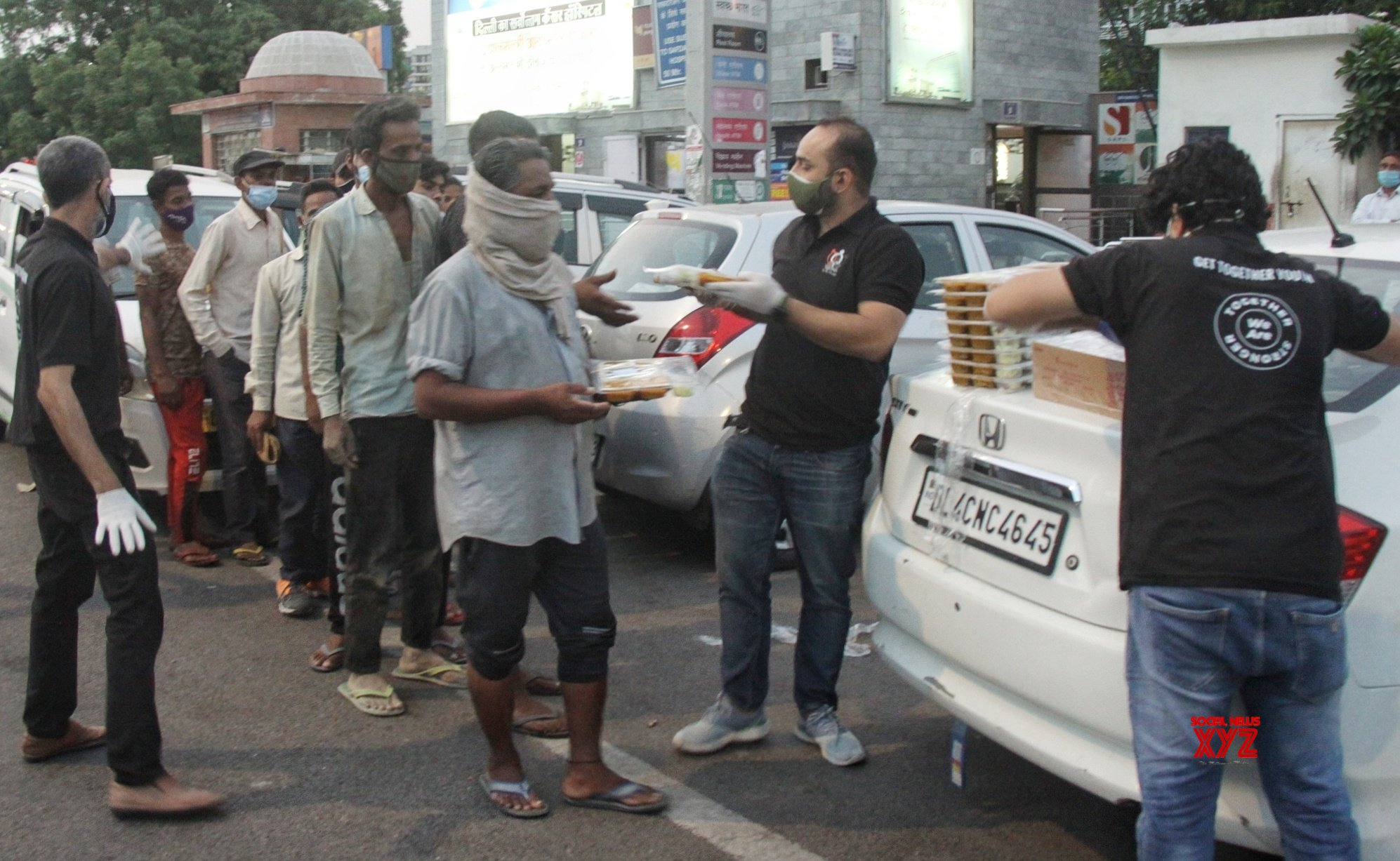 New Delhi : A group of Get Togather Youth admin Dawar Naqvi 29 - year - old with his friends distribute free foods, sanitizer for covid - 19 - pateints relatives out side AIIMS hospital in New Delhi. #Gallery