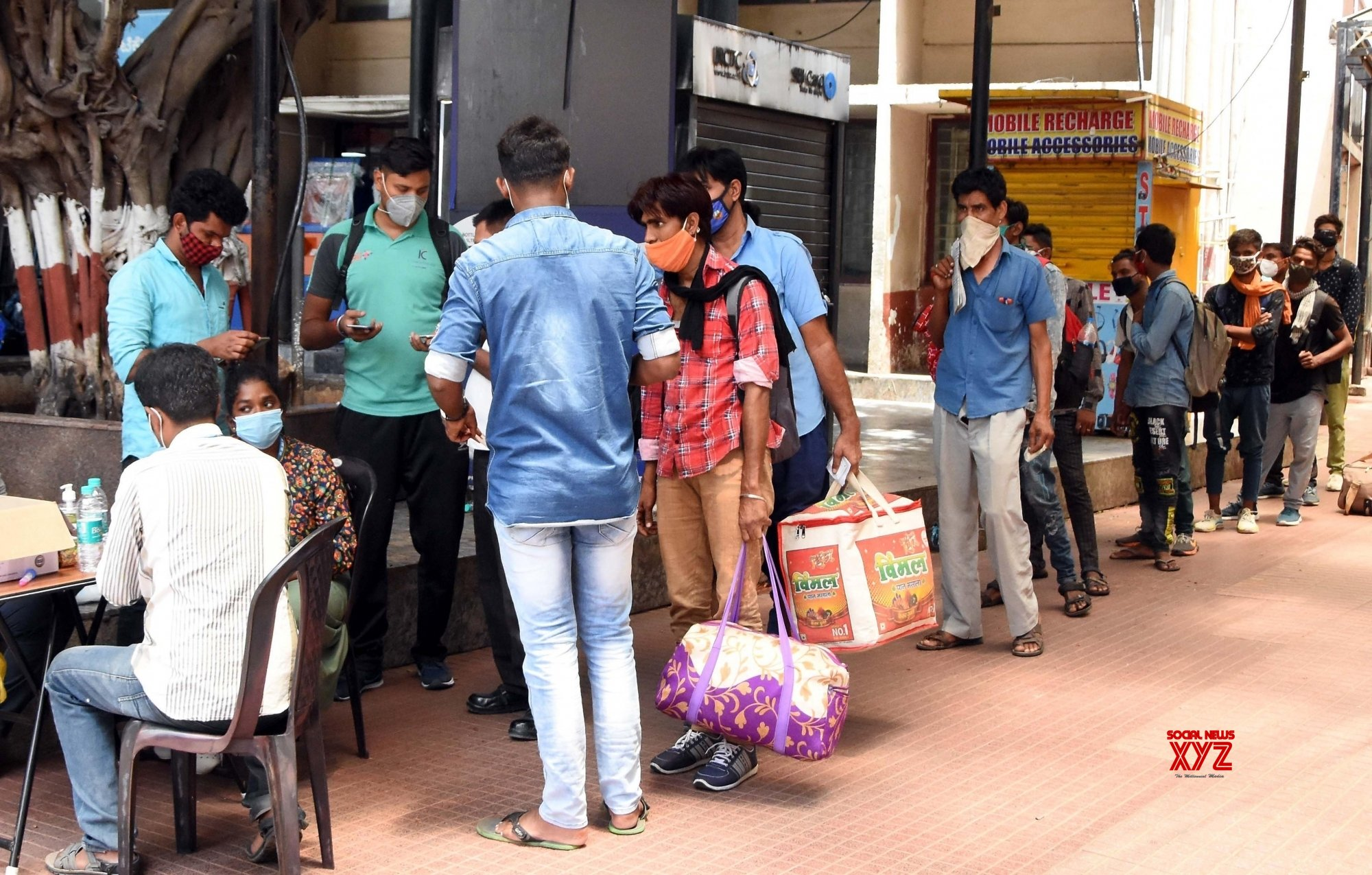 Bengaluru : Health worker collects swab samples for COVID - 19 tests at City Railway station, amid surge in coronavirus cases in Bengaluru. #Gallery