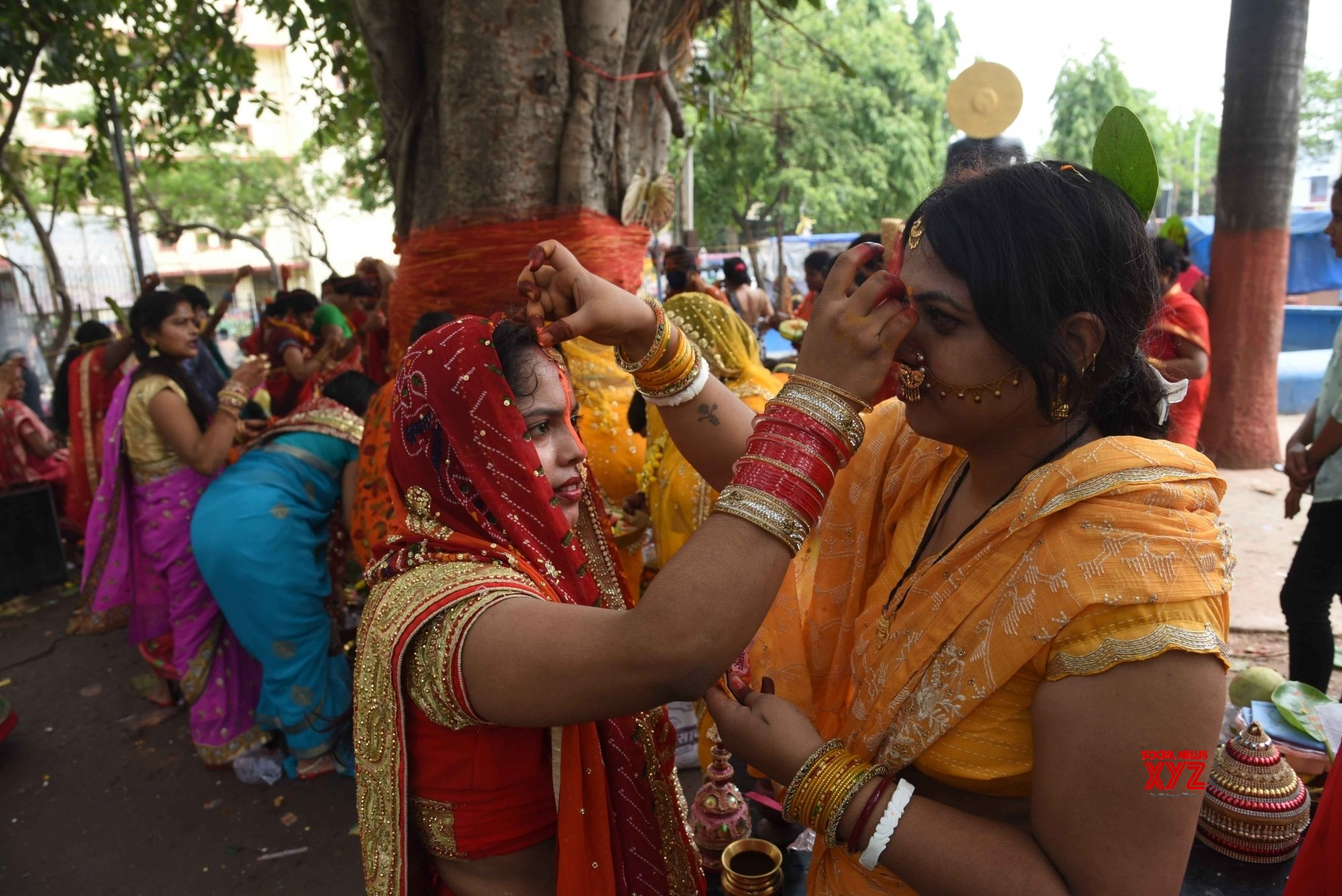 Patna: - Married women tie cotton threads around a banyan tree on the occasion of Vat Savitri Puja - in Patna. #Gallery