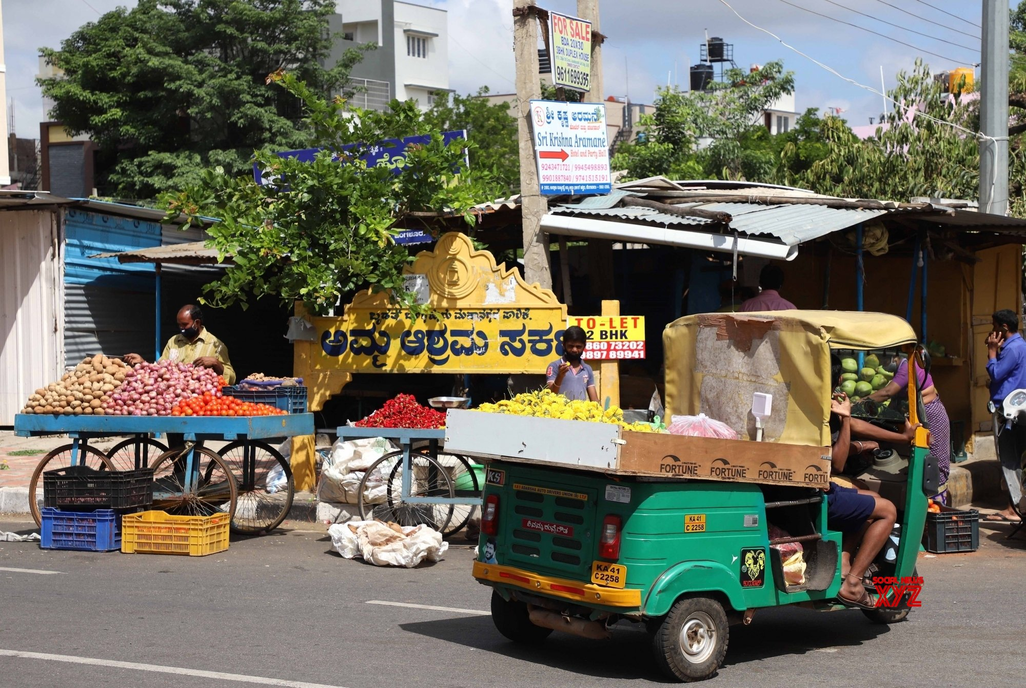 Bengaluru : - Public transportation auto rickshaw vehicles modified to sell vegetables, fruits and flowers due to the lockdown effect during Coronavirus lockdown - in Bengaluru. #Gallery