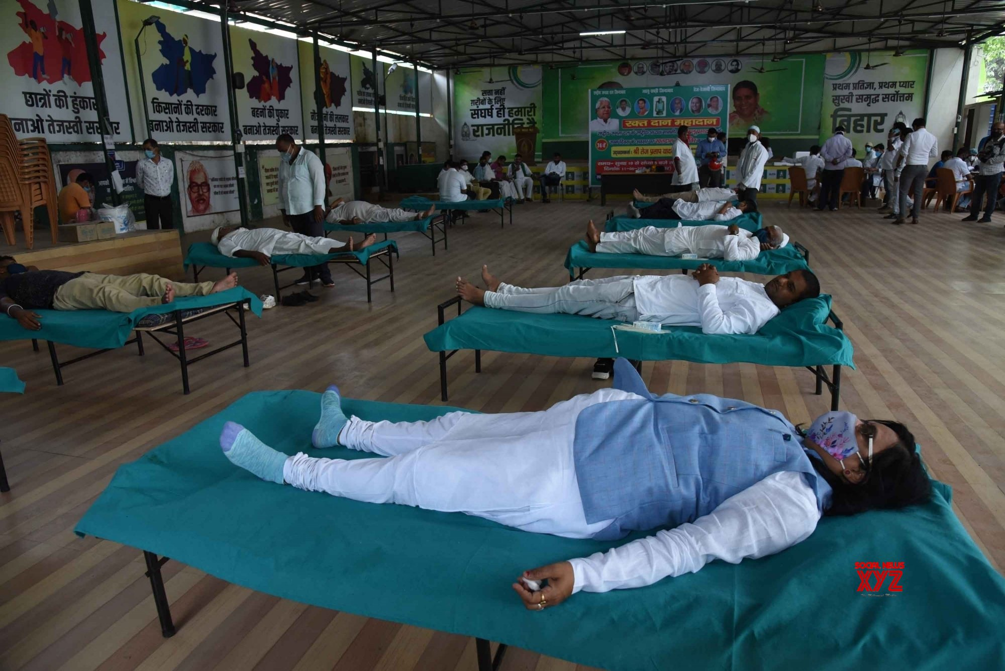 atna: - Rashtriya Janta Dal members and supporters at the mass level blood donation camp for needy during the celebrate the 74th birthday of party supremo Lalu Prasad in Patna. #Gallery