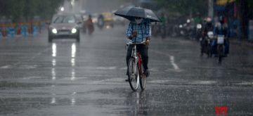 Kolkata:  People are crossing the road in the rain in Kolkata in Kolkata on Friday 11 June, 2021. (Photo: Kuntal Chakrabarty/ IANS)