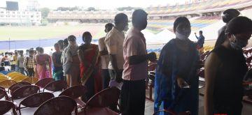 Ranchi: People being administered second dose of Covishield vaccine at Bhagwan Birsa Munda football stadium, in Ranchi on Saturday, July 17, 2021. (Photo: Rajesh Kumar/IANS)