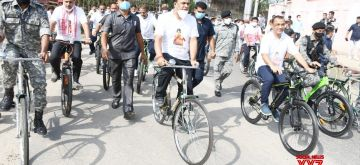 Guwahati: Assam Chief Minister Himanta Biswa Sarma participates in a cycle rally to wish boxer Lovlina Borgohain all the best for the Tokyo Olympic Games, in Guwahati on Wednesday, July 21, 2021.(photo:Anuwar hazarika/IANS)
