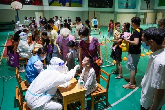 - Photo taken on July 21, 2021 shows medical workers take swab samples from residents for COVID - 19 test at a testing site in Nanjing, east China's Jiangsu Province. #Gallery