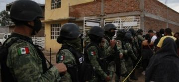 Members of the National Guard stand guard outside the rehabilitation center attacked by armed assailants in Irapuato, Guanajuato, Mexico, July 1, 2020 (Photo by Mario Armas/Xinhua/IANS)
