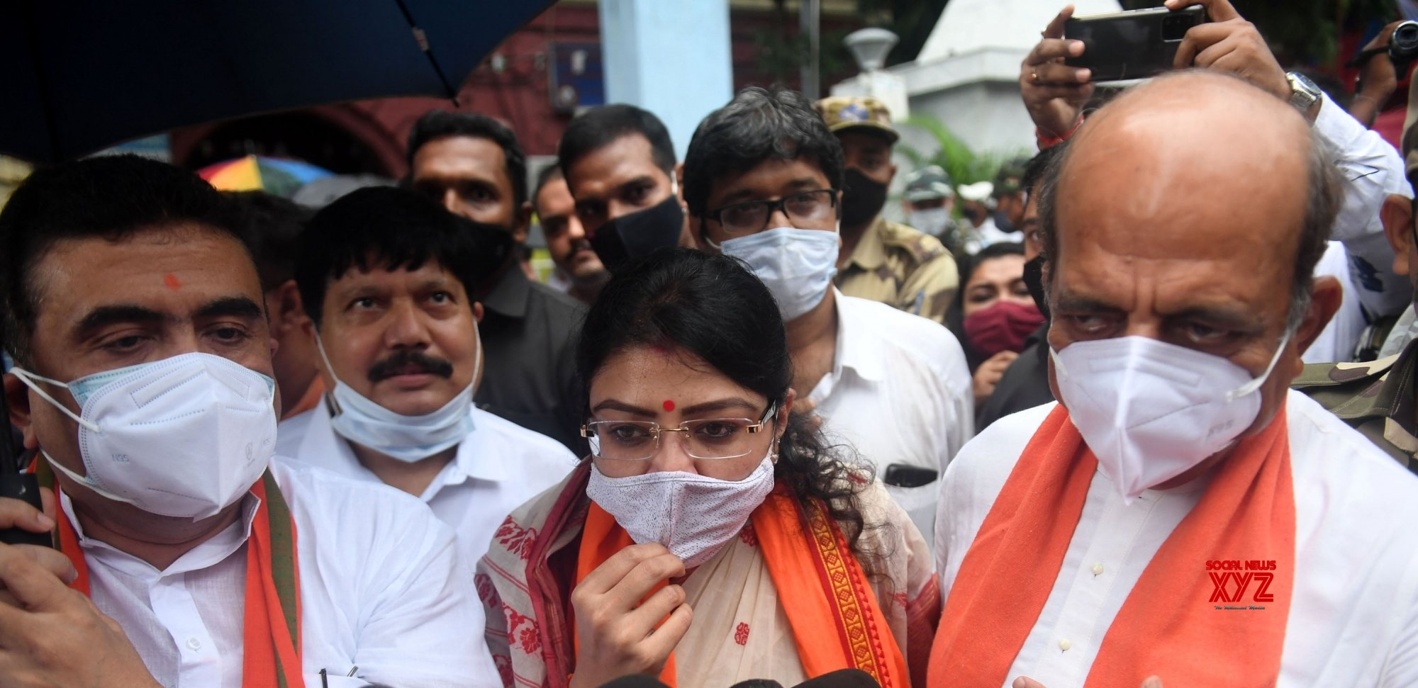 Kolkata: BJP candidate for Bhowanipore constituency by - poll, Priyanka Tibrewal with other BJP leaders after filling nomination comes out from Alipore Survey building in Kolkata #Gallery