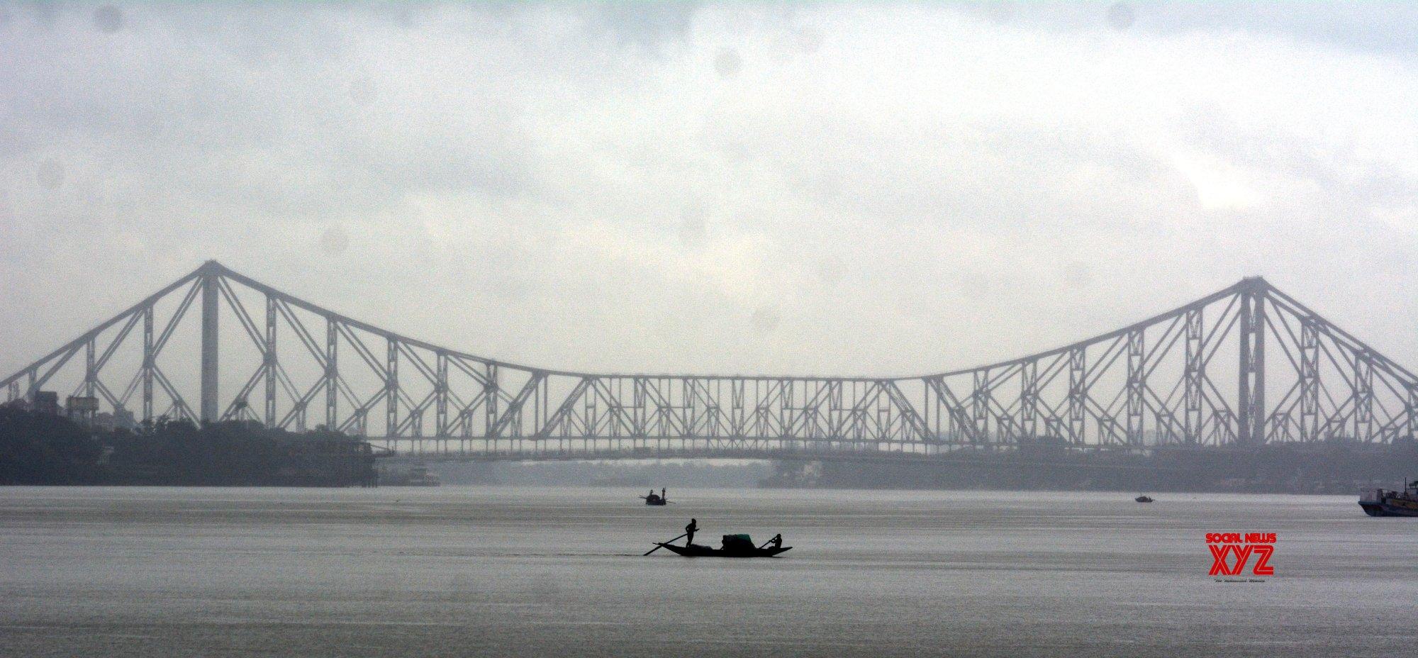 Kolkata: The sky is covered with clouds and rain over the river - Ganga - in Kolkata #Gallery