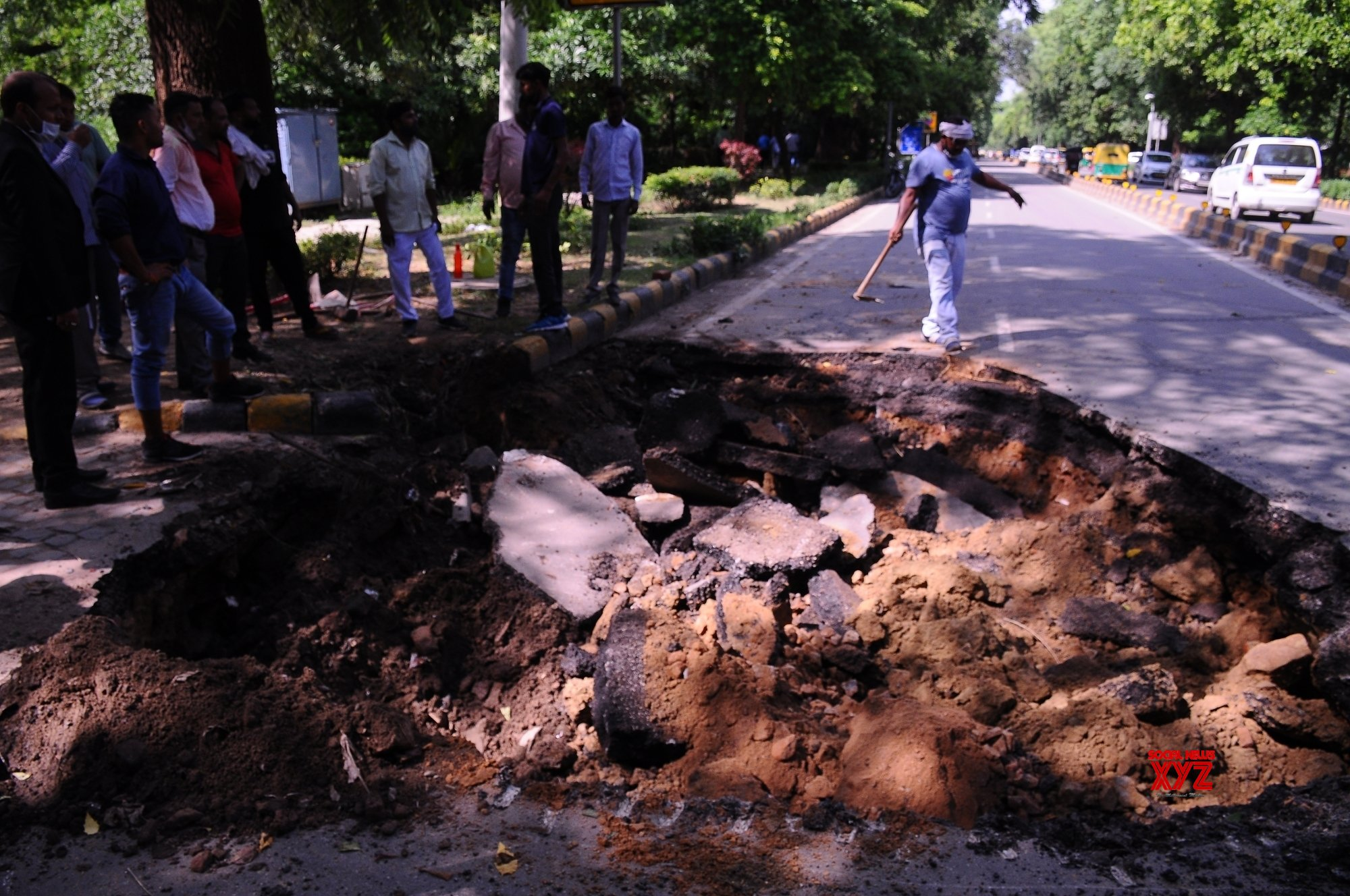 New Delhi: A portion of the road caved in at Copernicus Marg in Delhi. #Gallery