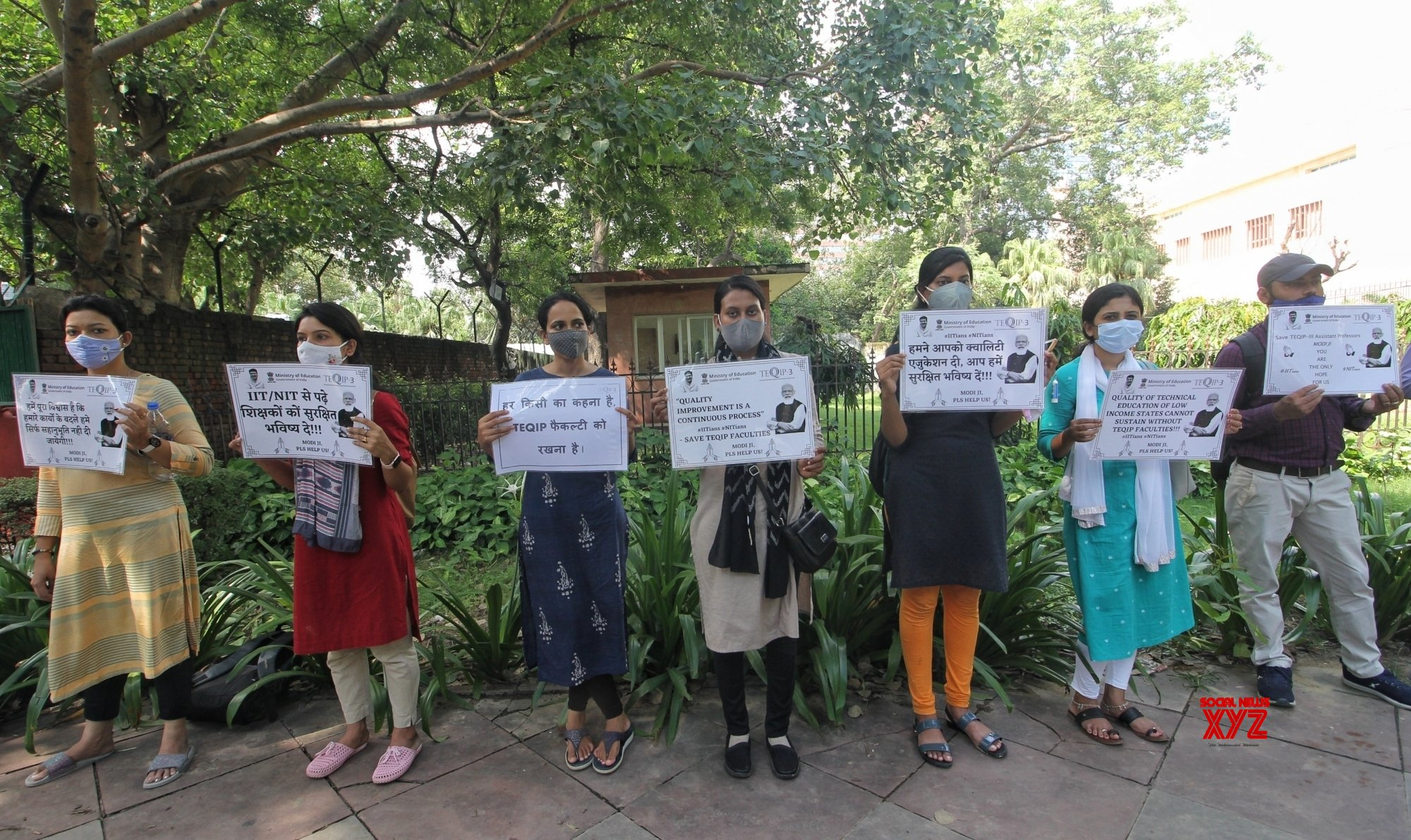 New Delhi : Assistant Professor of TEQIP hold a silent protest outside Education Ministry for their demand of a permanent job at Shastri Bhawan in New Delhi. #Gallery