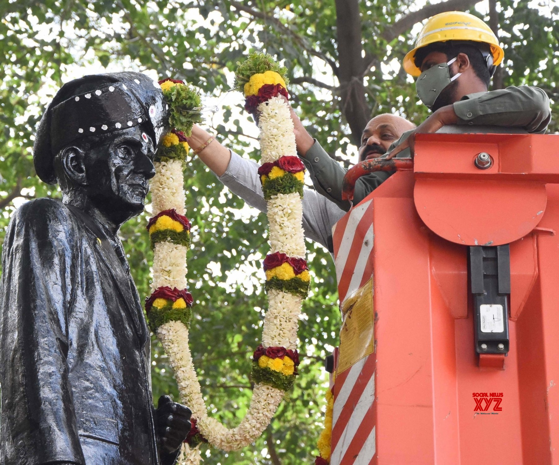 Bengaluru: Chief Minister of Karnataka Basavaraj Bommai garlanded the statue of Sir M Visvesvaraya during inauguration of - Sir M Visvesvaraya square at KR Circle on the occasion of National Engineers Day, in Bengaluru on Wednesday 15th September 2021 #Gallery
