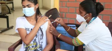 Bengaluru: A health worker administers a dose of the COVID-19 vaccine to a beneficiary, during COVID-19 mega vaccination drive at Chandra Layout in Bengaluru on Friday, September 17, 2021 (Photo: IANS)