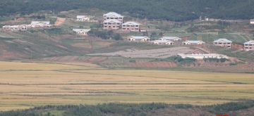 Yellow paddy fields in Kaepung County, North Hwanghae Province, North Korea, which is near the western part of the inter-Korean border, are seen in this photo taken at Odusan Unification Observatory in Paju, 30 kilometers north of Seoul, on Sept. 26, 2021. (Yonhap/END/IANS)
