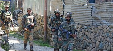 Bandipora: Soldiers in action during an encounter with militants in Aragam Chitti Bandi village of Jammu and Kashmir's Bandipora district on Sept 22, 2016. (Photo: IANS)