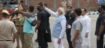 New Delhi : Prime Minister Narendra Modi welcomed by BJP leaders and supporters on his return to India from US visit, at Palam Airport in New Delhi on Sunday, September 26, 2021. (Photo: Anupam Gautam/ IANS)