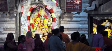 New Delhi: Devotees offer prayers at the Chattarpur Mandir on the first day of of the 9 day long Navratri Festival in New Delhi on Thursday October 07 , 2021.(Photo: Qamar Sibtain/IANS)