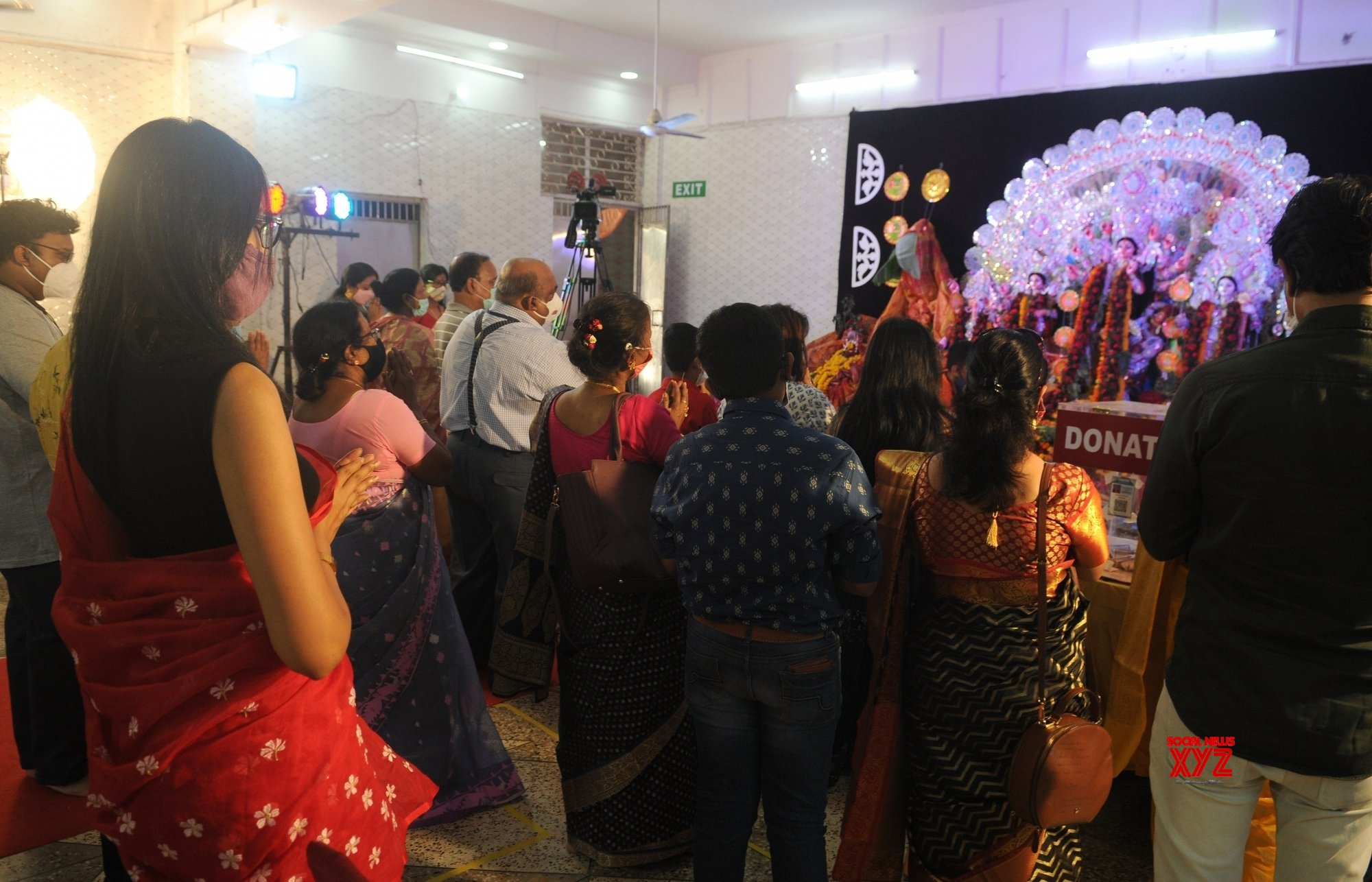 New Delhi: Devotees offer prayer to Goddess Durga on the occasion of Maha Asthami at a Community puja at Motia Khan #Gallery