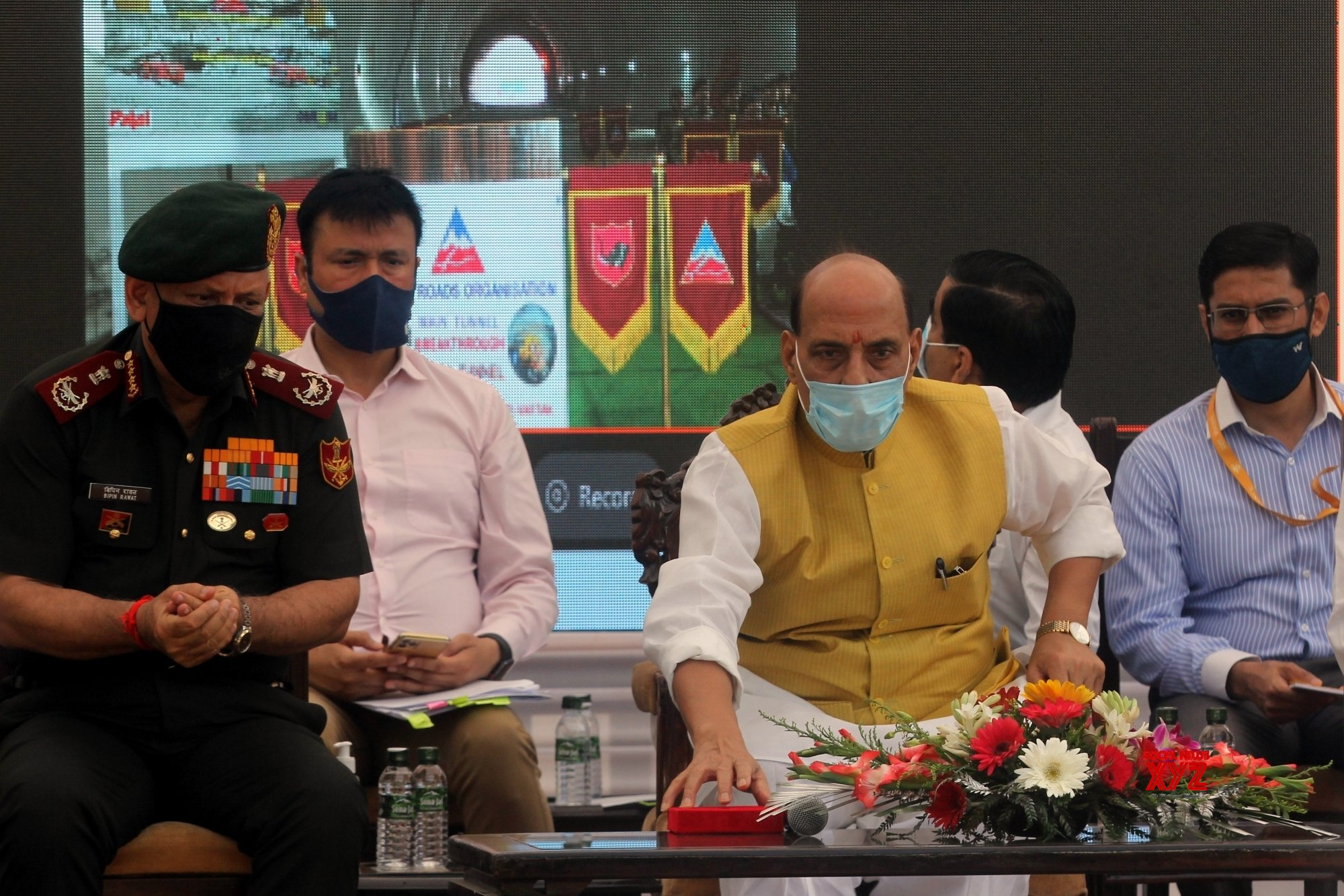 New Delhi: Union Defence Minister Rajnath Singh presides over breakthrough blast of Sela Main Tunnel vis video conferencing at an event organised by BRO India #Gallery