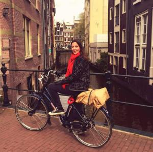 Emma Butterworth Social Enterprise Consultant sitting on bicycle on a bridge