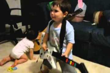2-year-old-playing-Bulls-on-Parade-on-Guitar-Hero.....the-music-takes-over