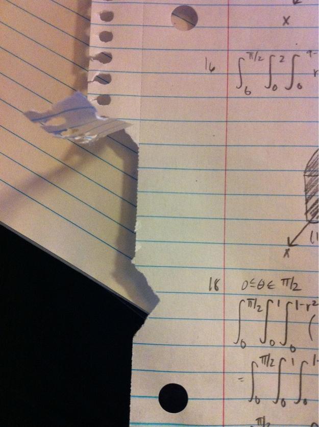 tear in margin of paper