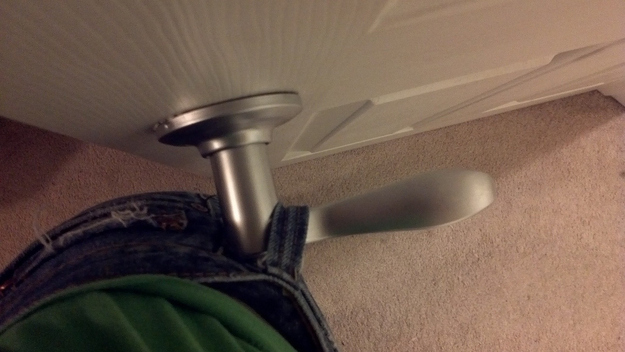 Jeans belt stuck round door handle