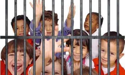 Kids-behind-Jail-Cell-Bars