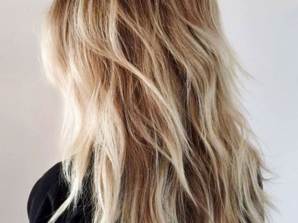 If you're looking for ways to change up your summer hairstyle, check out these summer haircuts for long hair you'll absolutely love!
