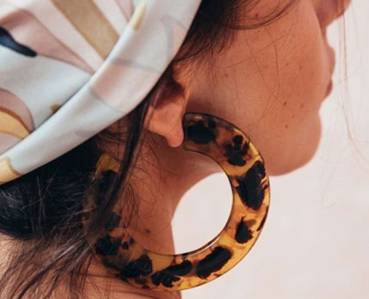 If you are looking for some accessories to make your outfit stand out, check out these plastic hoop earrings that are sure to do the trick!