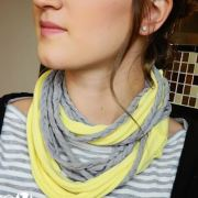 This is a really simple DIY t-shirt scarf that involves no sewing! All you need is an old t-shirt (or a few), and fabric scissors!