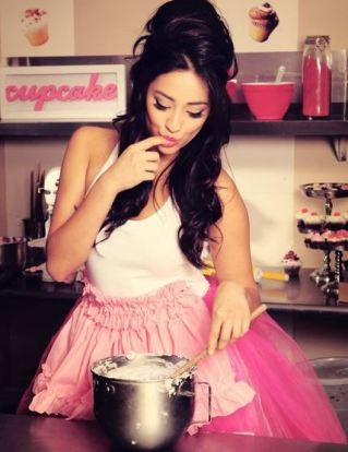 Wearing an apron will protect your clothes and make you that much cuter.