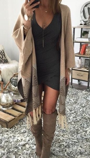 A black dress, cozy poncho and tall boots make for a perfect fall outfit!
