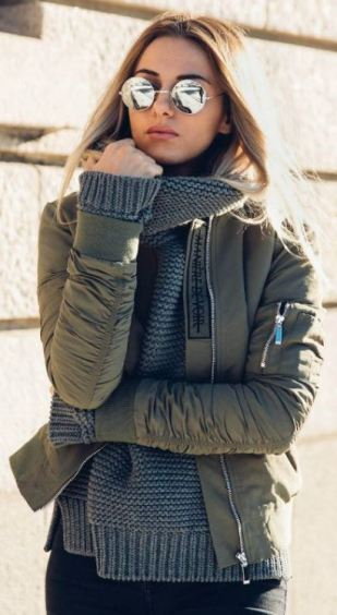 The look of this dark grey knit sweater underneath this army green bomber is so cute