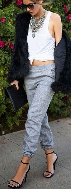 Pair sweatpants and heels with a statement necklace for a comfy fall outfit!