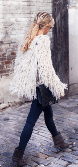 this cute cream colored shaggy coat is sure to keep you warm during the fall!