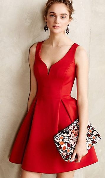 This red dress is so pretty paired with the clutch!