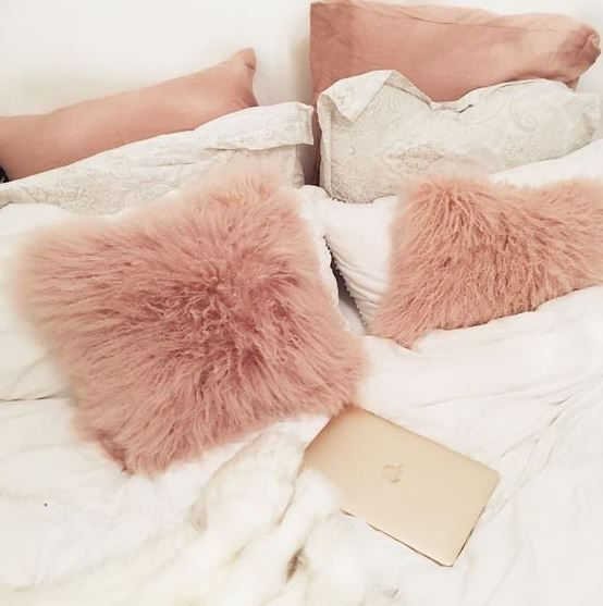 Furry pillows are great ways to make your bedroom cozy!