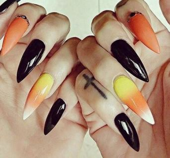 These classic nails are a great Halloween nail art design.