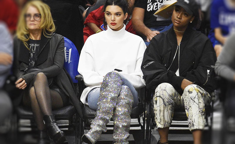 When Kendall Jenner is at a basketball game, she rocks the street style, trendy looks and always wears killer heels. She is the queen of bringing fashion courtside; here's a look at 11 Kendall Jenner Courtside Outfits you'll want to copy!