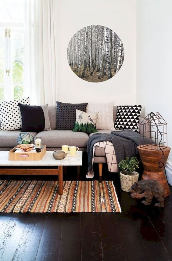 Try one of the best cute living room ideas with wooden accents and wall stickers.