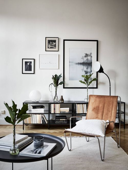 Try one of the best cute living room ideas with black accents and leafy greens.